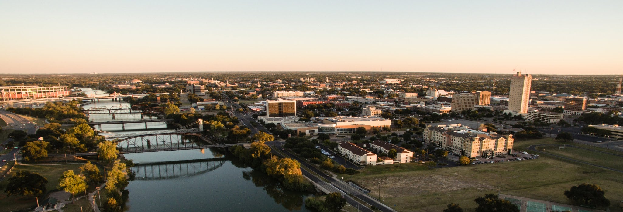 Sunset come to Waco Texas and the downtown river front