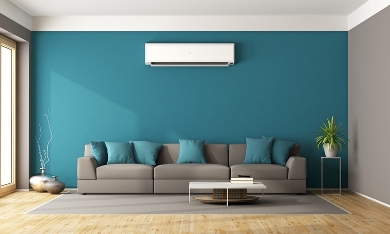 This is a modern living room with sofa and air conditioner as a 3d rendering
