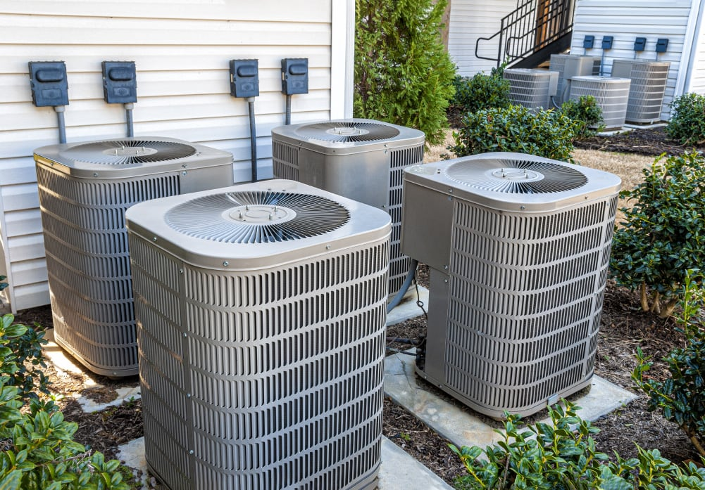 4 ac units by a house